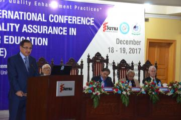 02- VC KMU Talking to Conferece while  Sectery HED Syed Zafar Ali shah, Member Ops & Planing Dr Ghulam Raza Bhatti setting on stage during first International conference on qulaity assurance (Custom)1513657699.JPG